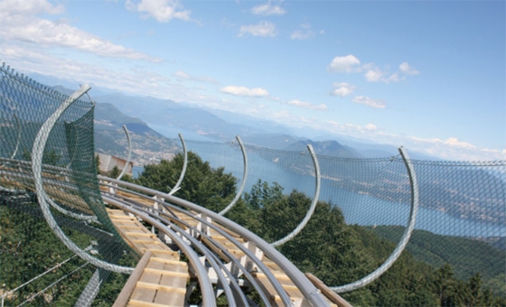 The amazing Mottarone Bob Coaster run, 750 metres of descent on tracks, complete with 360 degree turn, in two-person bobs equipped with brakes (even the bravest need to use them!!!). And all for just 4.50 euros a ride, discounts for multiple rides! Lake Maggiore in the distance.