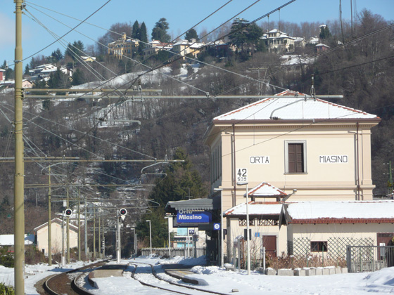 Orta-Miasino station in the snow, with the village of Miasino in the distance on the top of the hill (taken 15/2/2012)